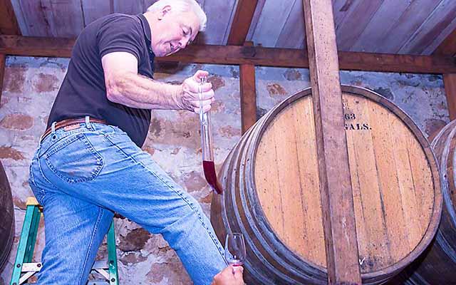 Mike Chelini pours a barrel sample of Cabernet Sauvignon