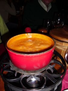 Fondue Valaisanne also for by the name Fondue Tomate. Instead of dipping bread, the cheese is ladled over small potatoes.
