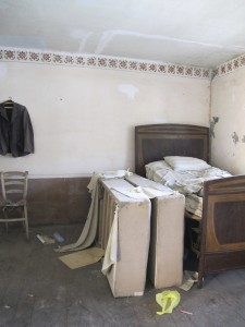 Beds with mattresses and clothes still hanging are some of the evidence of a culture gone by.