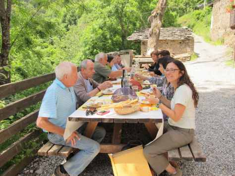 Chiara Boschis enjoying lunch al fresco at Rifugio Valliera in Castelmagno.