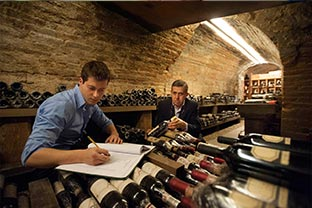 Enrico Cordero and son Giampiero in Ristorante Il Centro's lauded wine cellar.