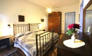 One of the cozy rooms at Agriturismo Cascina delle Rose.
