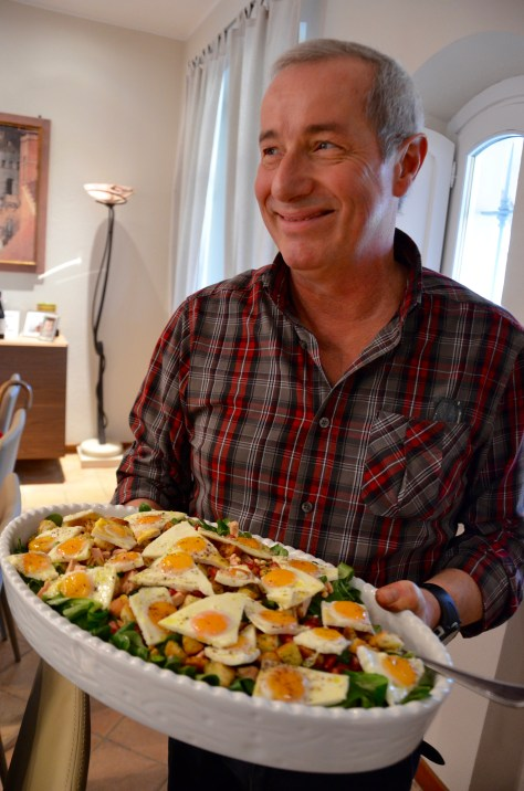 Antonio Deltetto proudly displaying the panzanella salad.
