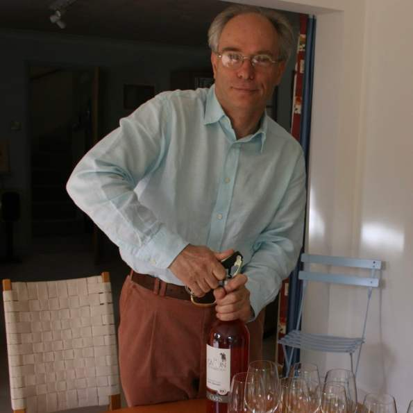 David Way opening a bottle of wine