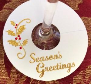 Season's Greetings Wine Glass Tags are elegantly embossed in foil.