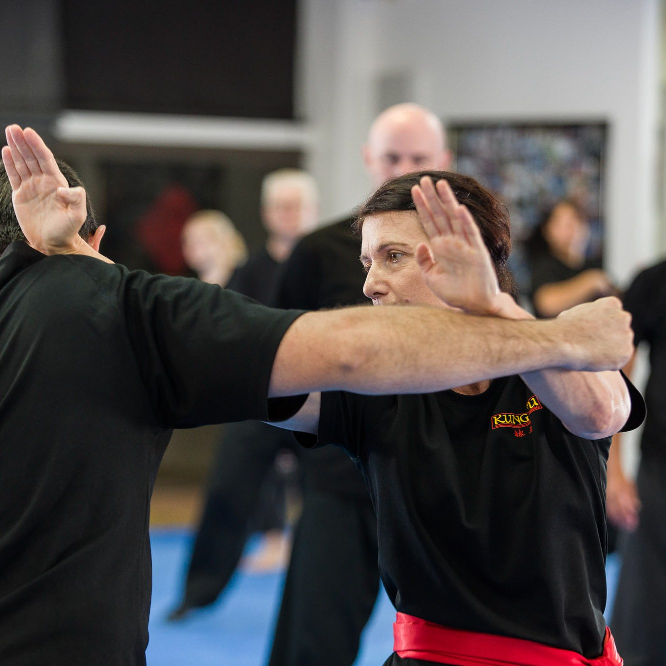 Woman applying kung fu round punch defence. Wing Chun Kung Fu Studio 118 South Pine Road Brendale Qld Australia.