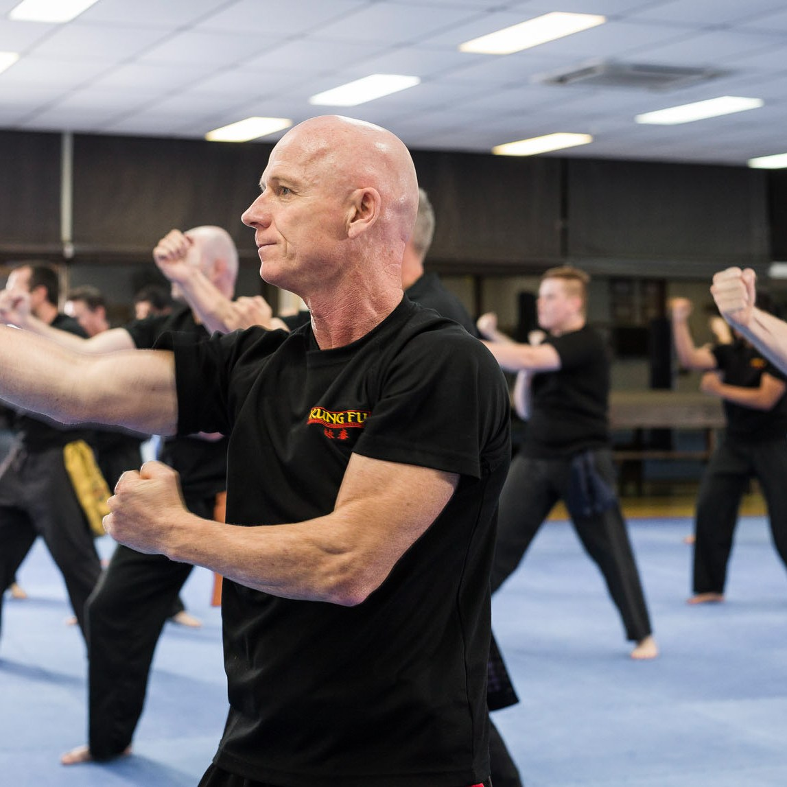 Sifu Paul running students through basic drills training kung fu classes at the Wing Chun Kung Fu Studio 118 South Pine Road Brendale Qld Australia.