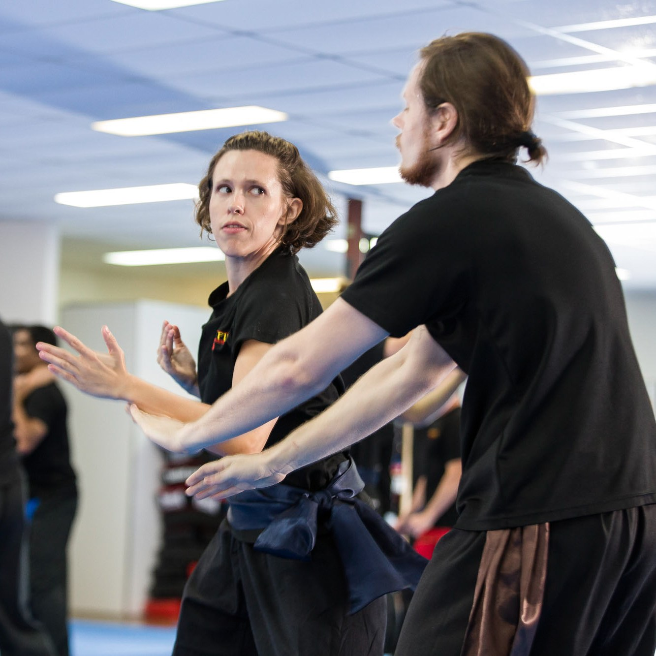 Young woman practicing Kung fu Self defence against throat grab.