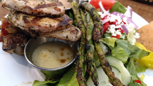 "The ""pork feast"" with pork cutlets, apple chutney, grilled asparagus and the house salad at Tazikis Cafe in Germantown TN"