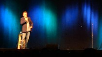 Comedian Brian Regan performing on stage at the Deadwood Mountain Grand Casino