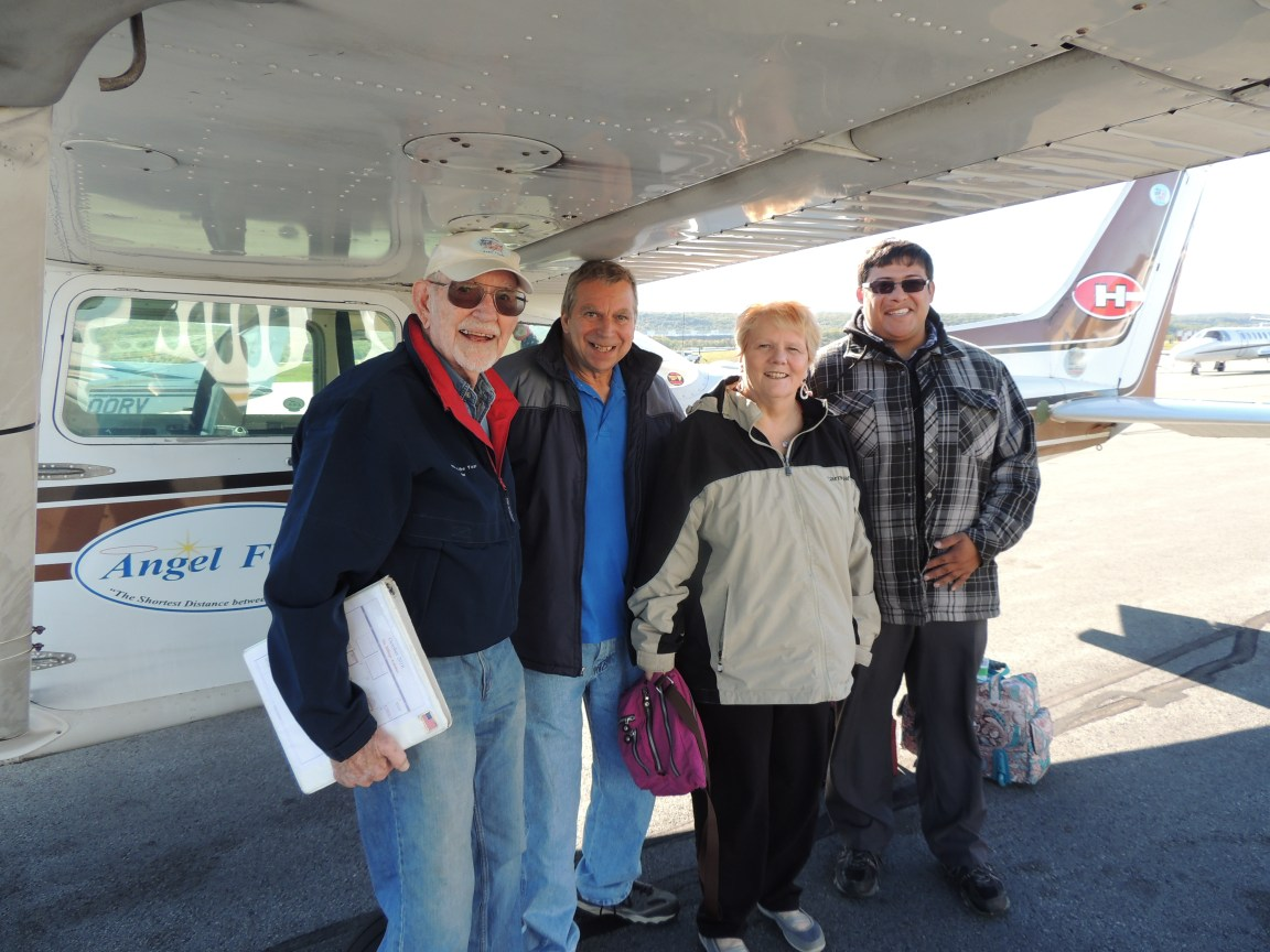 Adeline with her Husband and Son along with Captain John