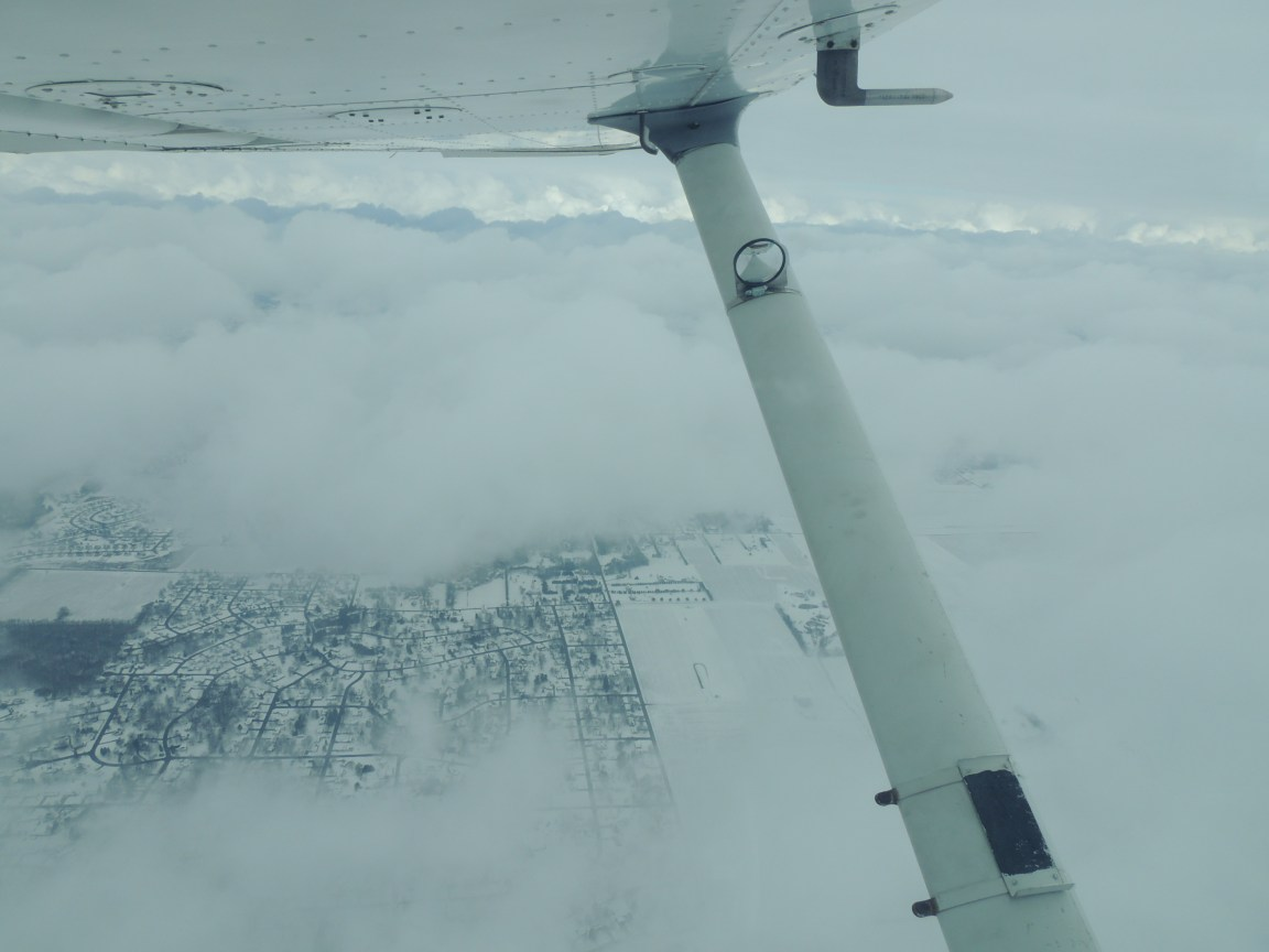 Climbing up thru the clouds leaving Akron, heading for Harrisburg PA