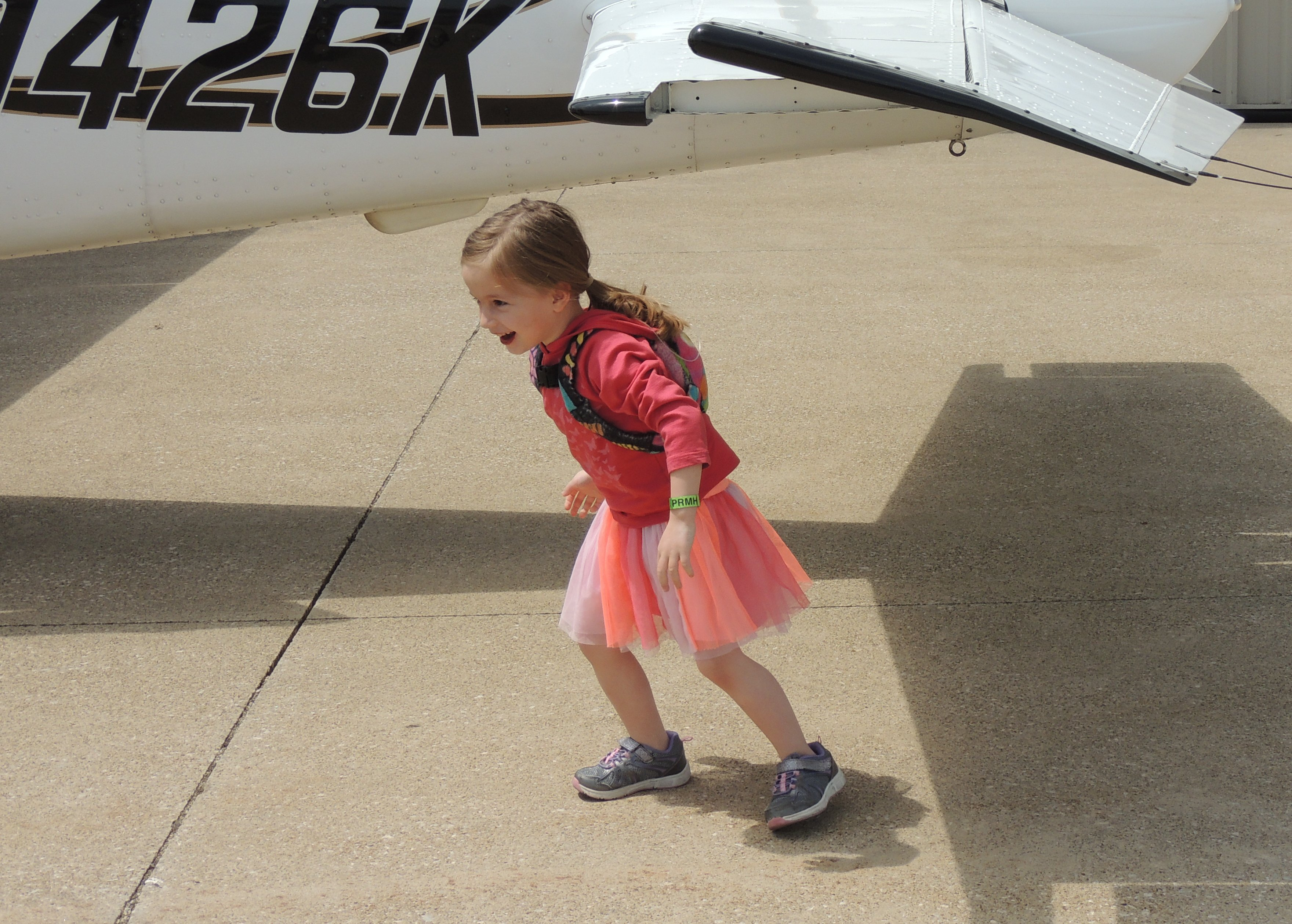 Evelyn full of energy after her nap on our flight !