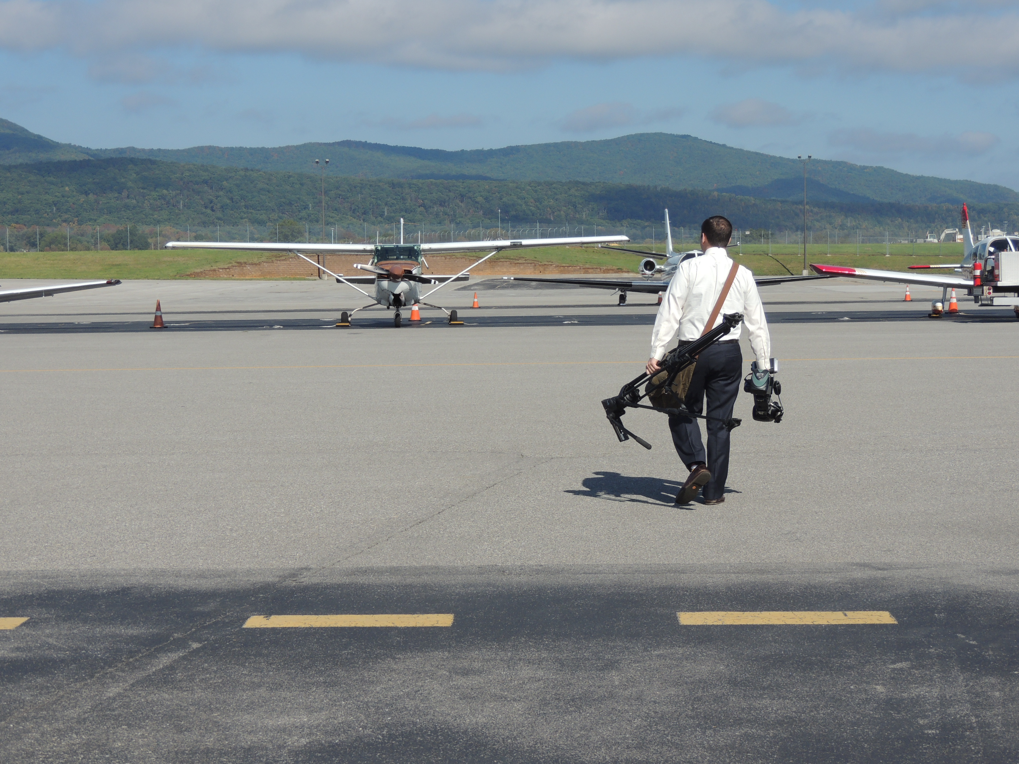 Roanoke TV 10 walking out to the Airplanes