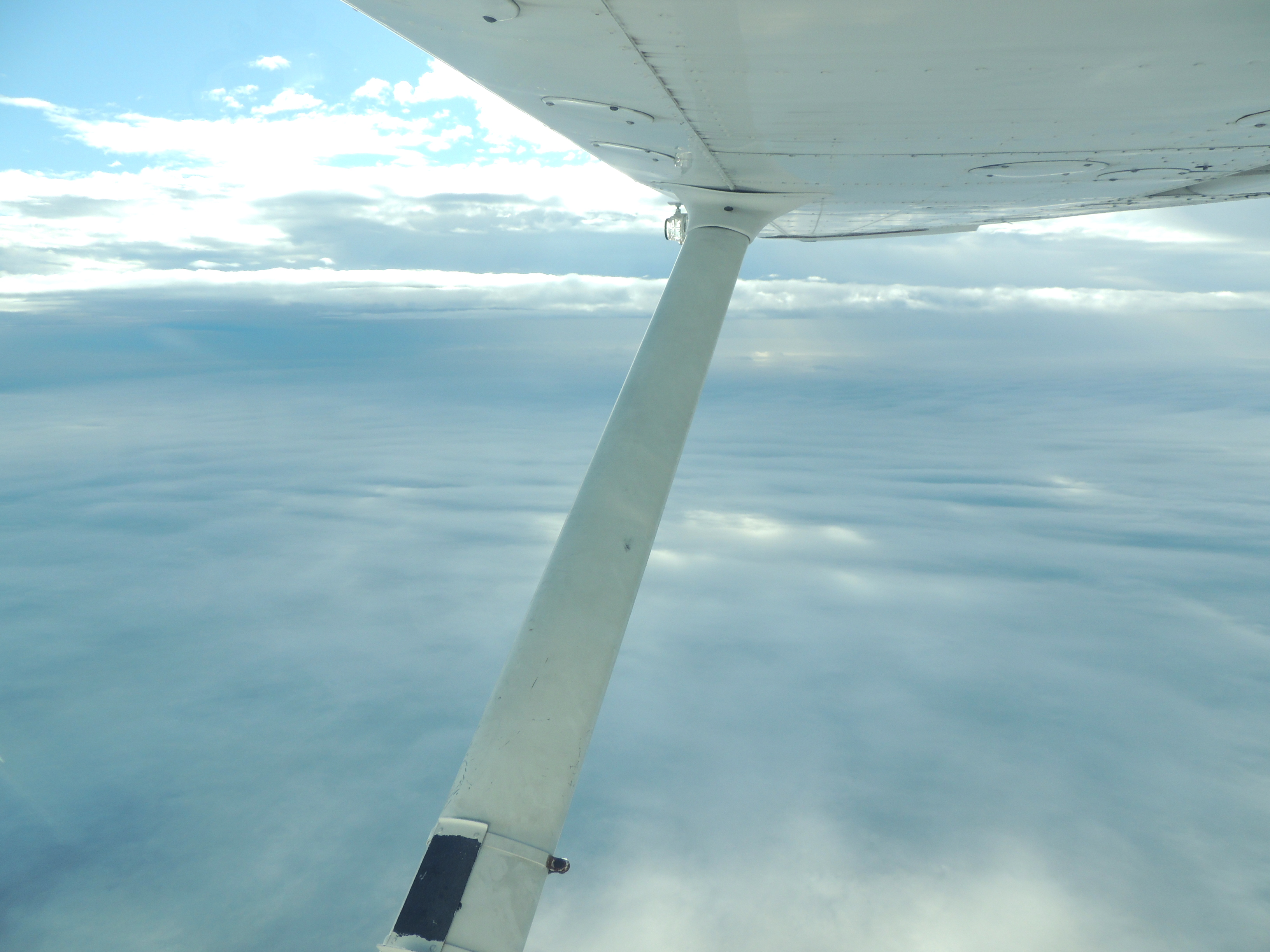 Above a low deck of clouds heading to Baltimore MD