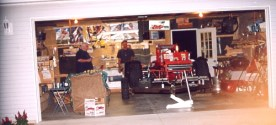 The Tynan brothers look at Rod Rothgarn's supermodified as it sits in Rich and Sherry Grote's garage in Indiana