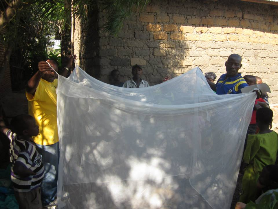 Wings of Hope for Africa distributes mosquito netting as a part of an anti-malaria education project - donate to our charity and help to stop malaria in East Africa
