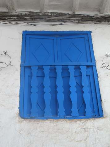Blue window shutters, San Blas, Cusco, Peru, South America