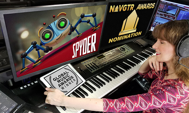 Photo of video game music composer Winifred Phillips in her music production studio.  This photo illustrates the awards and accolades received by the music of the Spyder video game.