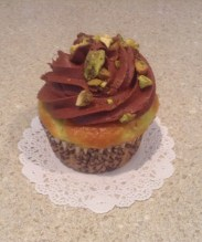 Pistachio Cupcake with Chocolate Cream Cheese Frosting Garnished with Pistachios