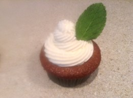 Pineapple Rum Mojito Cupcake with Pineapple Rum Buttercream Garnished with Fresh Mint