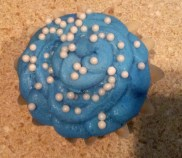 Peanut Butter Cupcake Filled with Peanut Butter with a Vanilla Buttercream Frosting & White Chocolate Pearls