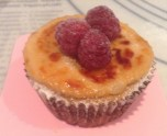 Crème Brûlée Cupcake with Fresh Raspberry Garnish