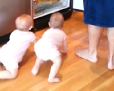 Dad tries to start breakfast but his twins have their own agenda.