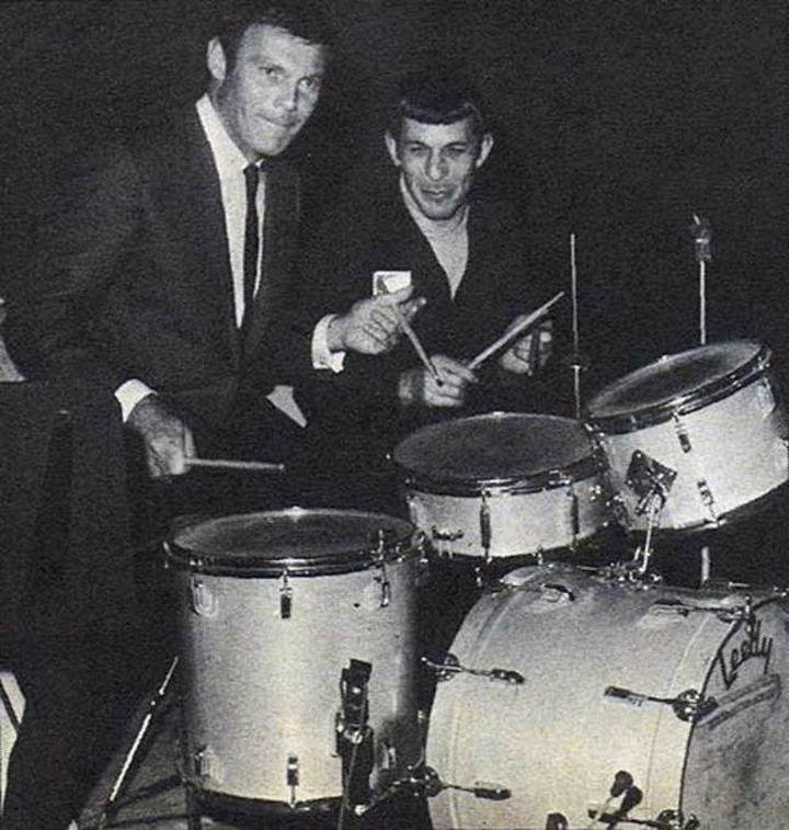 Adam West (Batman) & Leonard Nemoy (Spock) playing on a drum set.