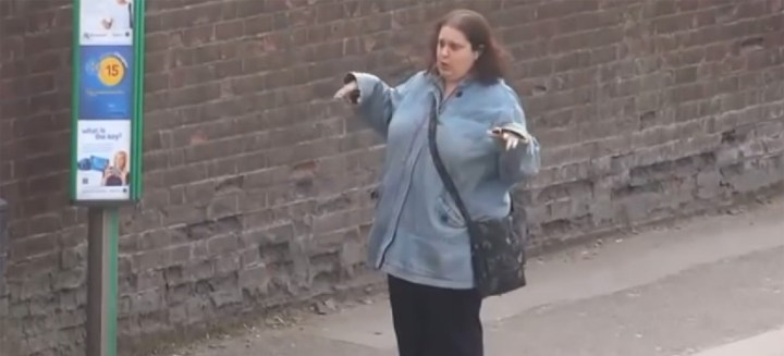 This woman dancing at a bus stop can't stop dancing.