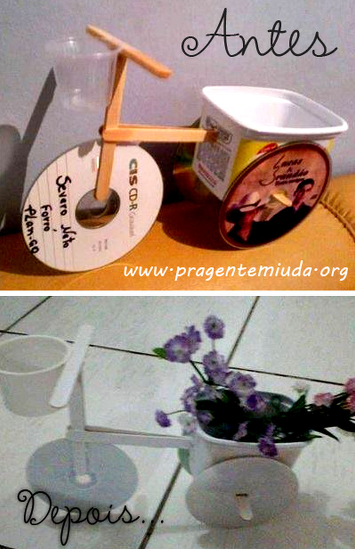 16 DIY Projects Using Old and Scratched CDs - Build a tricycle flower pot.