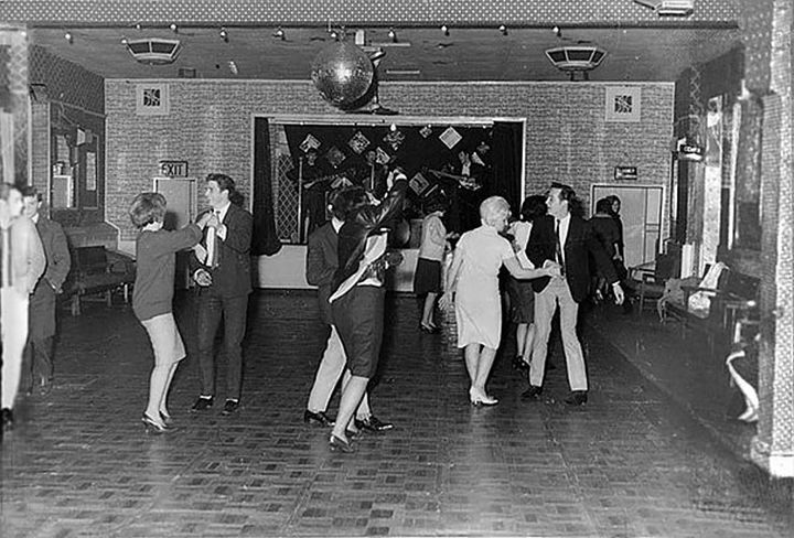 21 Historical Photos - The Beatles play for 18 people at the Aldershot Club, 1961. They were to become superstars in one and a half years time.