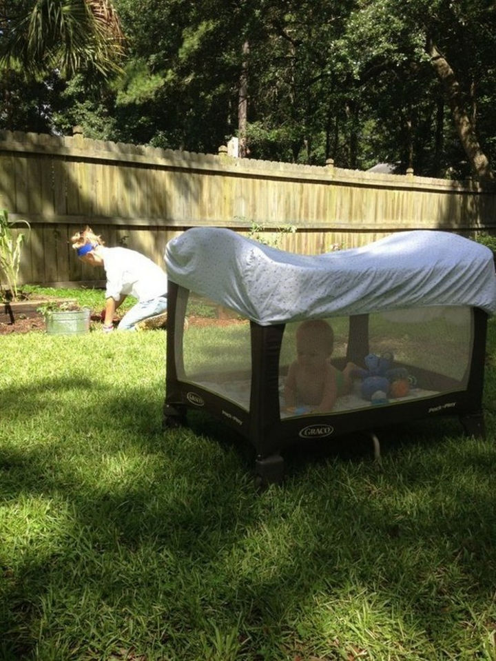 24 Life Hacks for Kids - Prevent flies, mosquitoes, or other insects from harming your child by putting a blanket over their playpen.