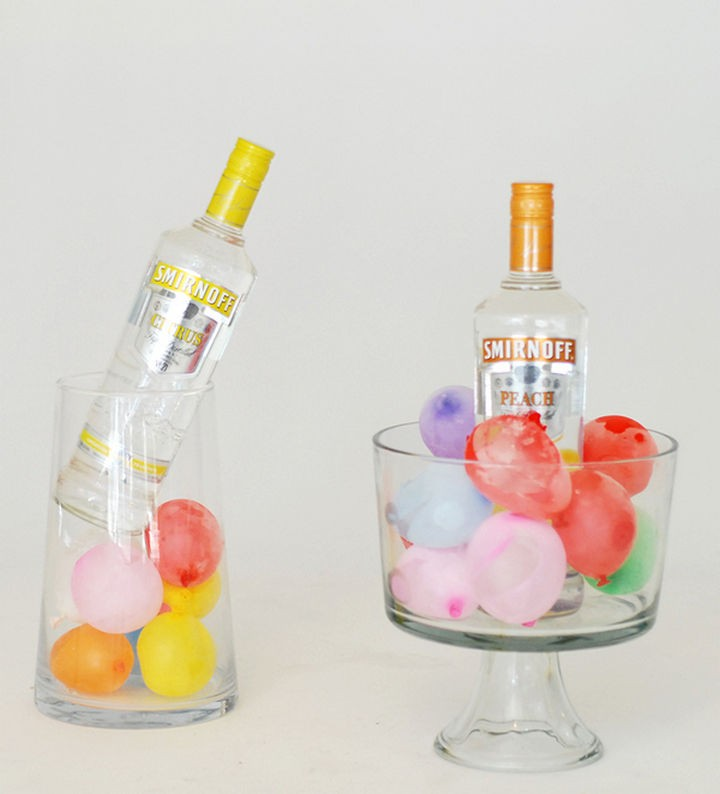 16 Party Hacks - Use frozen water balloons to keep drinks cold.