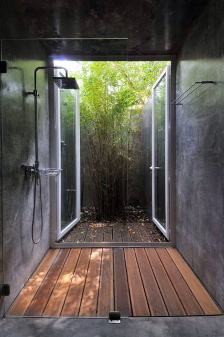 13 Beautiful Showers - Shower with doors leading outside.
