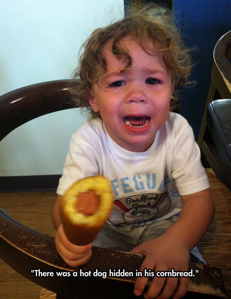 37 Photos of Kids Losing It - There was a hot dog hidden in his cornbread.
