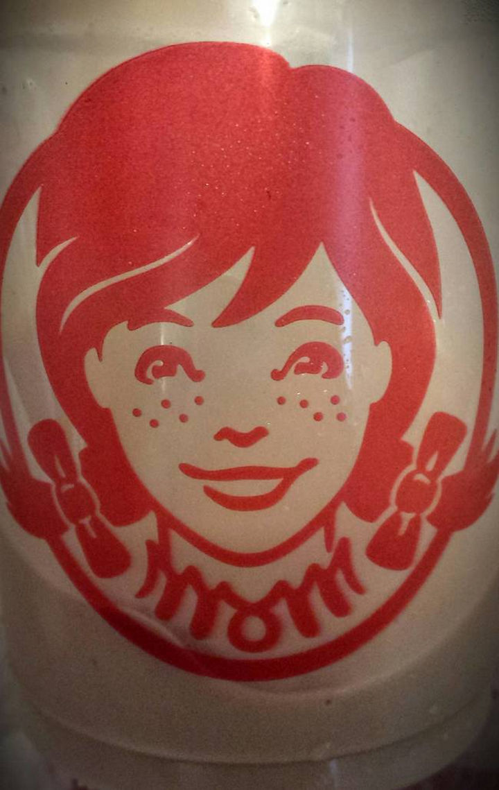 "25 Things That Can't Be Unseen - Wendy's collar spells out ""Mom"" in the classic Wendy's logo."