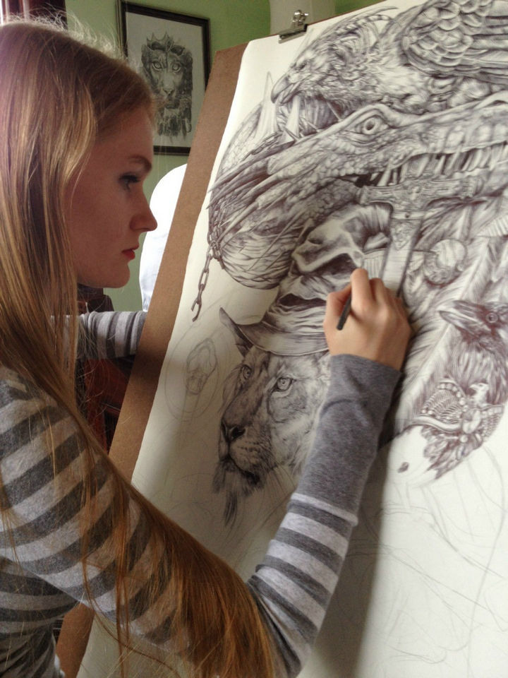 On day 8, Savannah is halfway done and adding details to the upper portion of the piece.