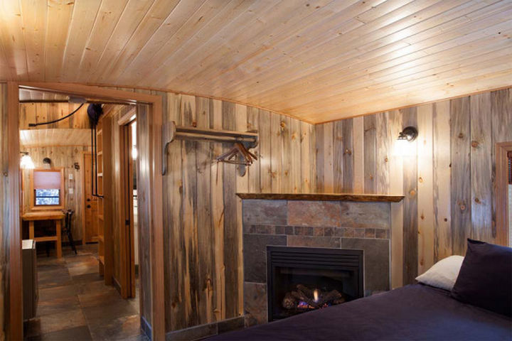It has all the amenities of a modern dwelling and even includes a beautiful fireplace in the bedroom.