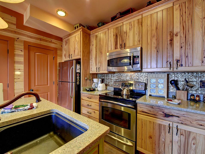 The kitchen still keeps the rustic feel but has the convenience of modern appliances and amenities.
