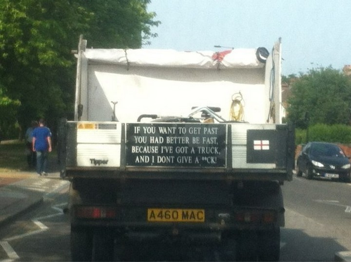 31 Funny Truck Signs - He's a poet and he doesn't know it.