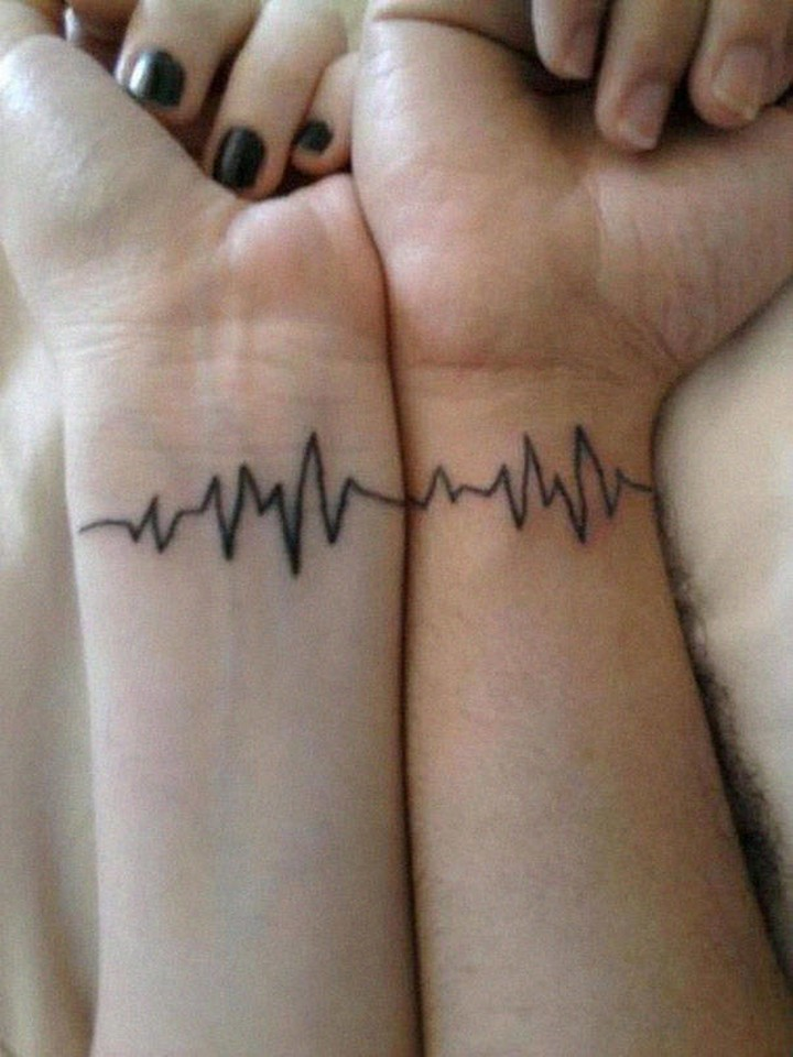 35 couple tattoos - Two hearts beating as one couple tattoos.