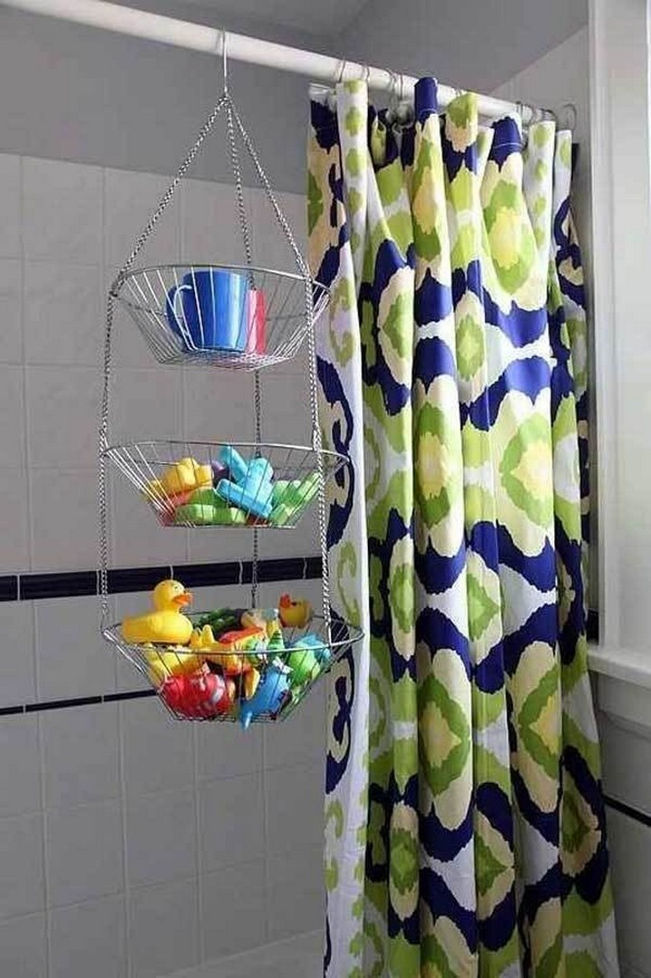 46 Useful Storage Ideas - Store wet toys after bath time in a metal hanging fruit basket.