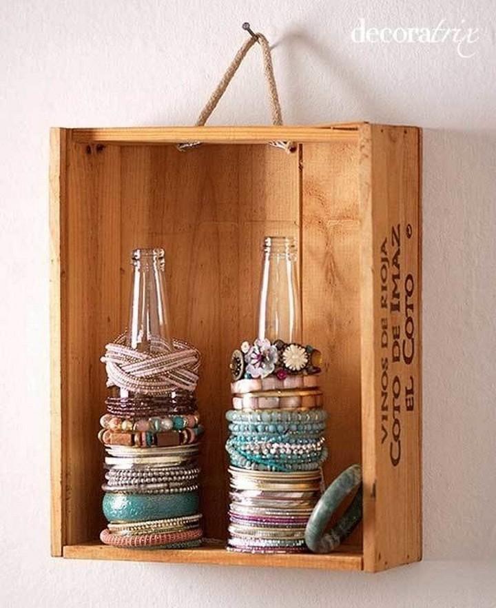 46 Useful Storage Ideas - Use empty glass bottles as bracelet holders.