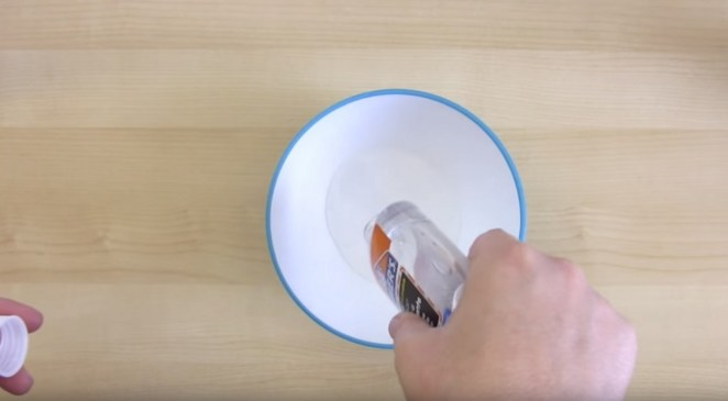 How to make glitter slime - Step 1: In a bowl, pour a 4 or 5-ounce bottle of clear glue..