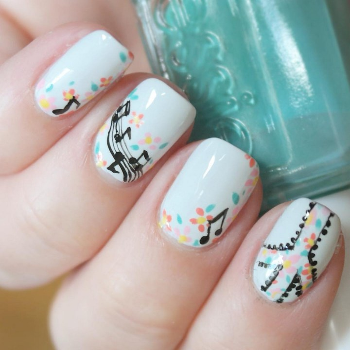 18 Music Nails - Give peace a chance with these musical psychedelic nails.