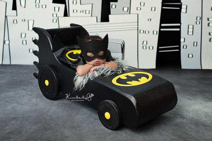 37 Newborns Wearing Geek Baby Clothes - Baby Batman taking a nap.