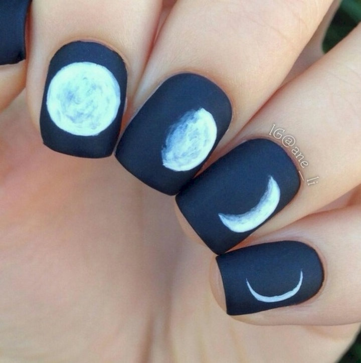 22 Black Nails That Look Edgy and Chic - Moon phases manicure.