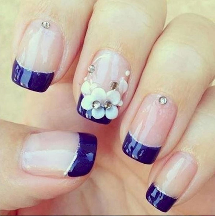 17 French Nails With a Twist - Dark blue with a lovely floral accent.