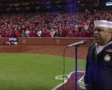 Retired Navy Officer Generald Wilson sings 'God Bless America' .